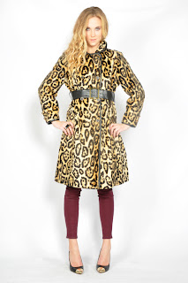 Vintage 1960's faux fur leopard peacoat with button front closure and black leather belt.