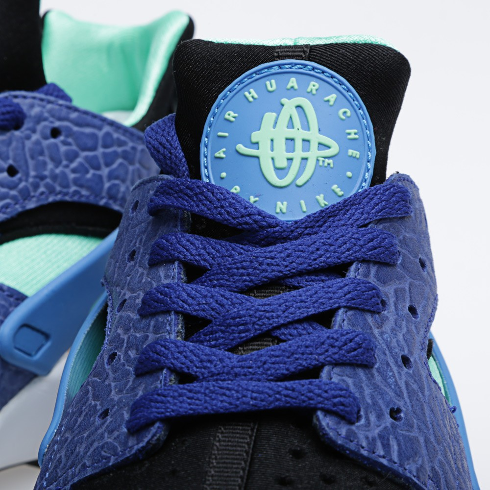 pretty nice 119e8 7fb95 This new Huarache colorway features a black and teal neoprene upper with  blue leather and elephant print overlays. A classic white midsole and blue  heel ...