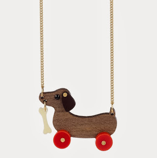 http://www.edinburghart.com/shop-2/dog-on-wheels-necklace/