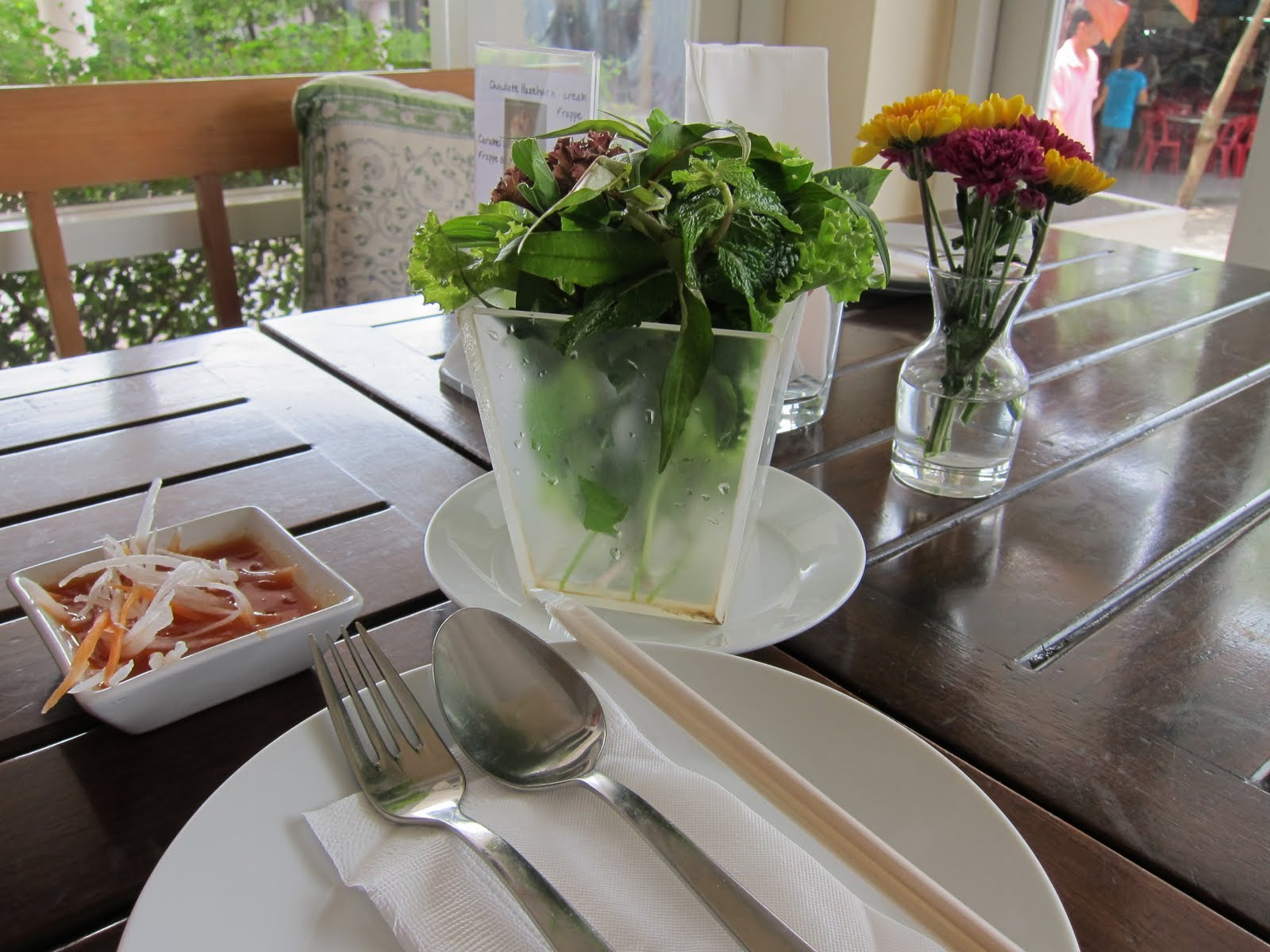 Simple restaurant table setting - The Table Setting Is Simple But We Were Reminded Immediately That We Were In A Vietnamese Restaurant When They Placed A Container Full Of Fresh Herbs And A