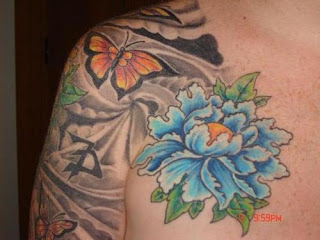Butterfly and Flower Chest Piece Tattoo Design