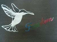 stencil of a bird and the word freedom
