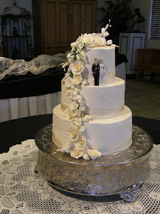 3-tier round buttercream with gumpaste flowers