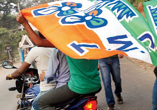 bikers holding Trinamul Congress party flag