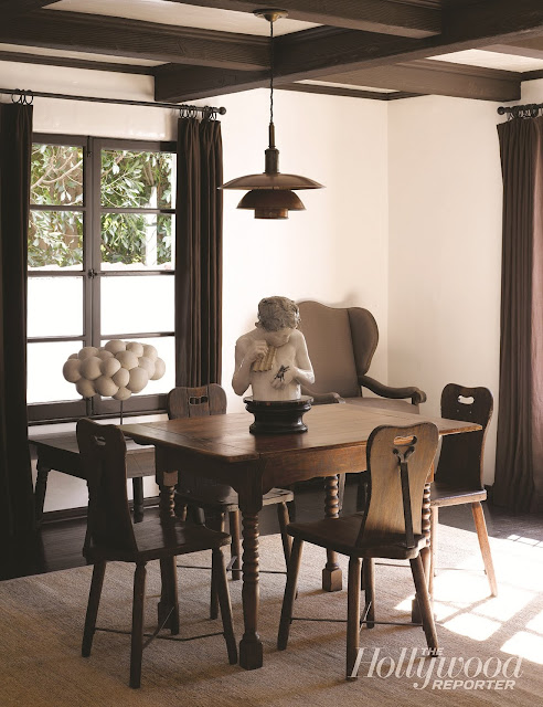 breakfast nook with pendant light, white walls, large windows and floor length brown curtains