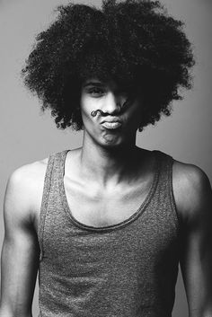 A black man with a cool long afro hairstyle for his natural hair