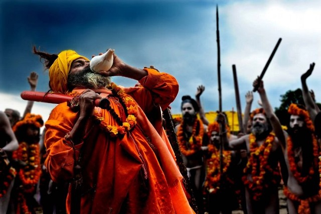 Sage playing the conch in Nashik Kumbh Mela