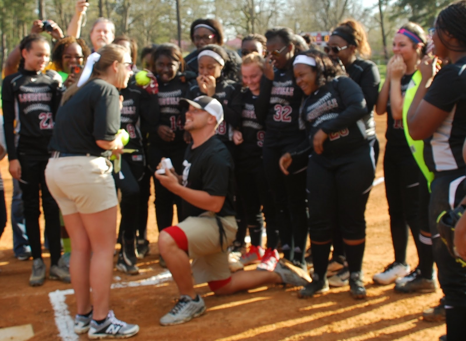 Beautiful Coach Proposes Marriage To Coach On Louisville Softball Field!