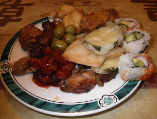 My plate during the first round with a sampling of many of the restaurant offerings.