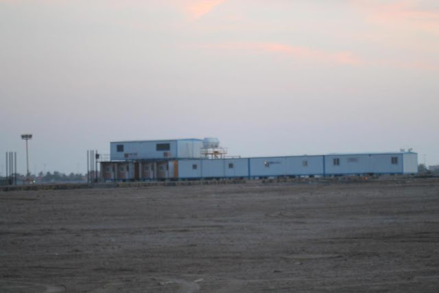 Picture of white construction houses on the Kingdom Tower construction site