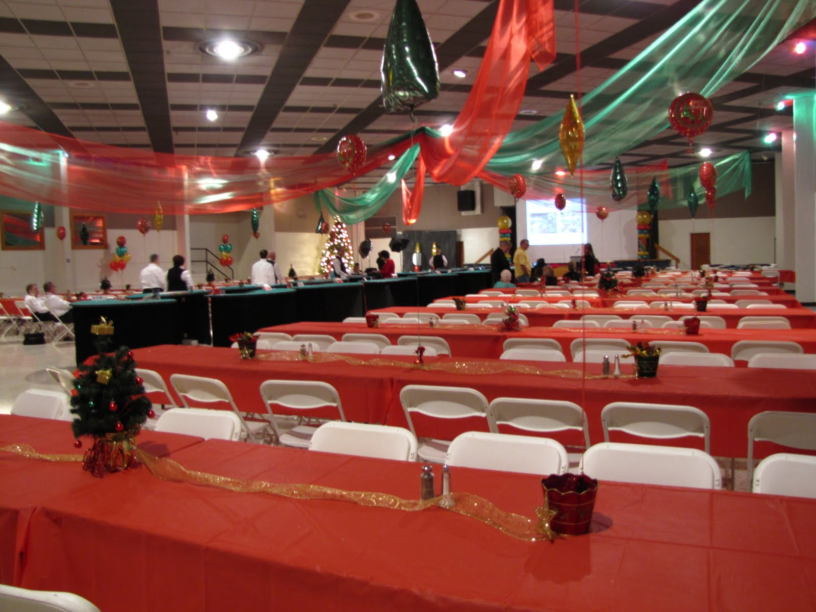 Party people event decorating company christmas party for Christmas ceiling decorations