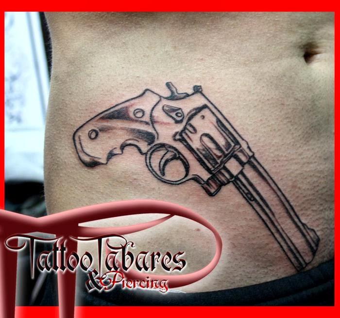 Revolver Tatuaje tattoos: revolver cintura