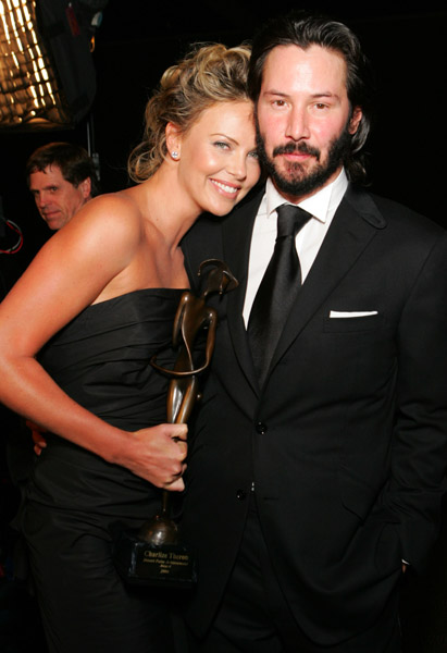 Keanu Reeves with Charlize Theron