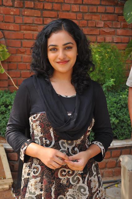 Nithya Menon Hot Pics From Okkadine Movie Shooting