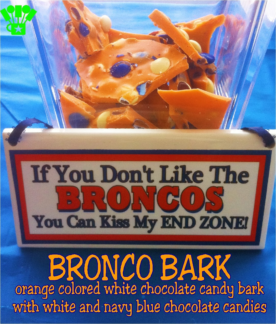 Denver Bronco Candy Bark. An orange colored white chocolate candy bark with white and navy blue chocolate candy pieces.  YUMMY! And great for cheering on the Broncos #Broncos #Candy #SuperBowl