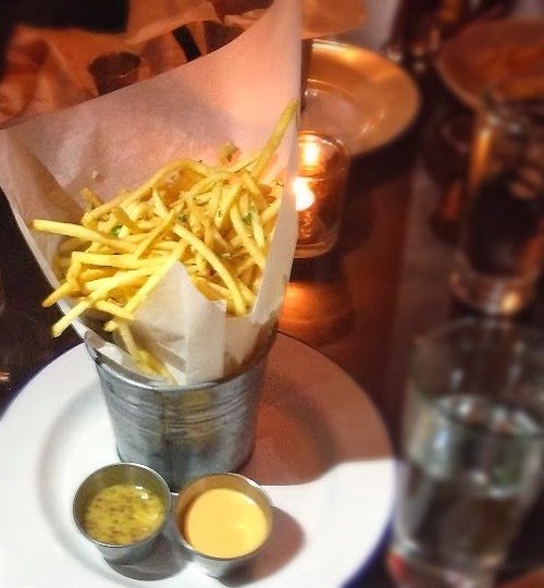 shoestring french fries served in a small tin bucket
