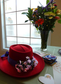 Red hat & flowers - Photo by Patricia Stimac, Seattle Wedding Officiant