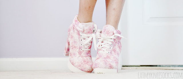 Front details on the pink floral-print white lace-up high-heel platform booties from AMIClubwear.