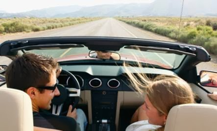 Survey Reveals Road Trips Improve Couples' Connections - man woman driving car