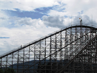 Jupiter: Wooden Roller Coaster Against Rain Clouds