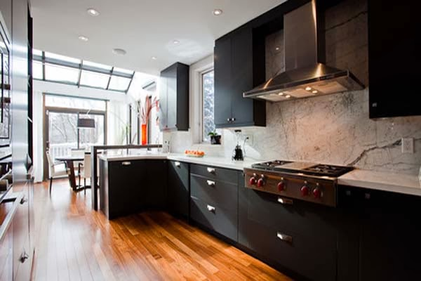 http://www.hivenn.com/wp-content/uploads/2013/07/Spacious-Modern-Style-Black-Kitchen-Cabinets-Fireplace-Wooden-Flooring.jpg