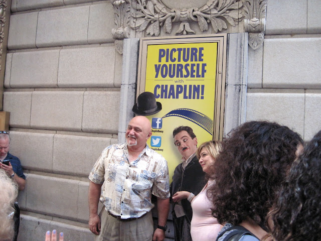 Patrons picture themselves as Chaplin before heading into the Old New York theater, The Barrymore