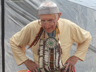 golden volunteer in beads and feathers
