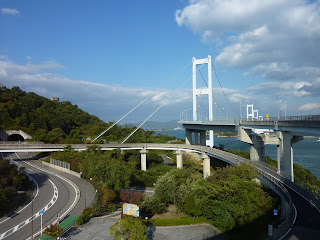 View from the Imbari, Shikoku side of the Kurushima-Kaikyo bridge with the looping downramp of the Shimanami Kaido bike way in the foreground