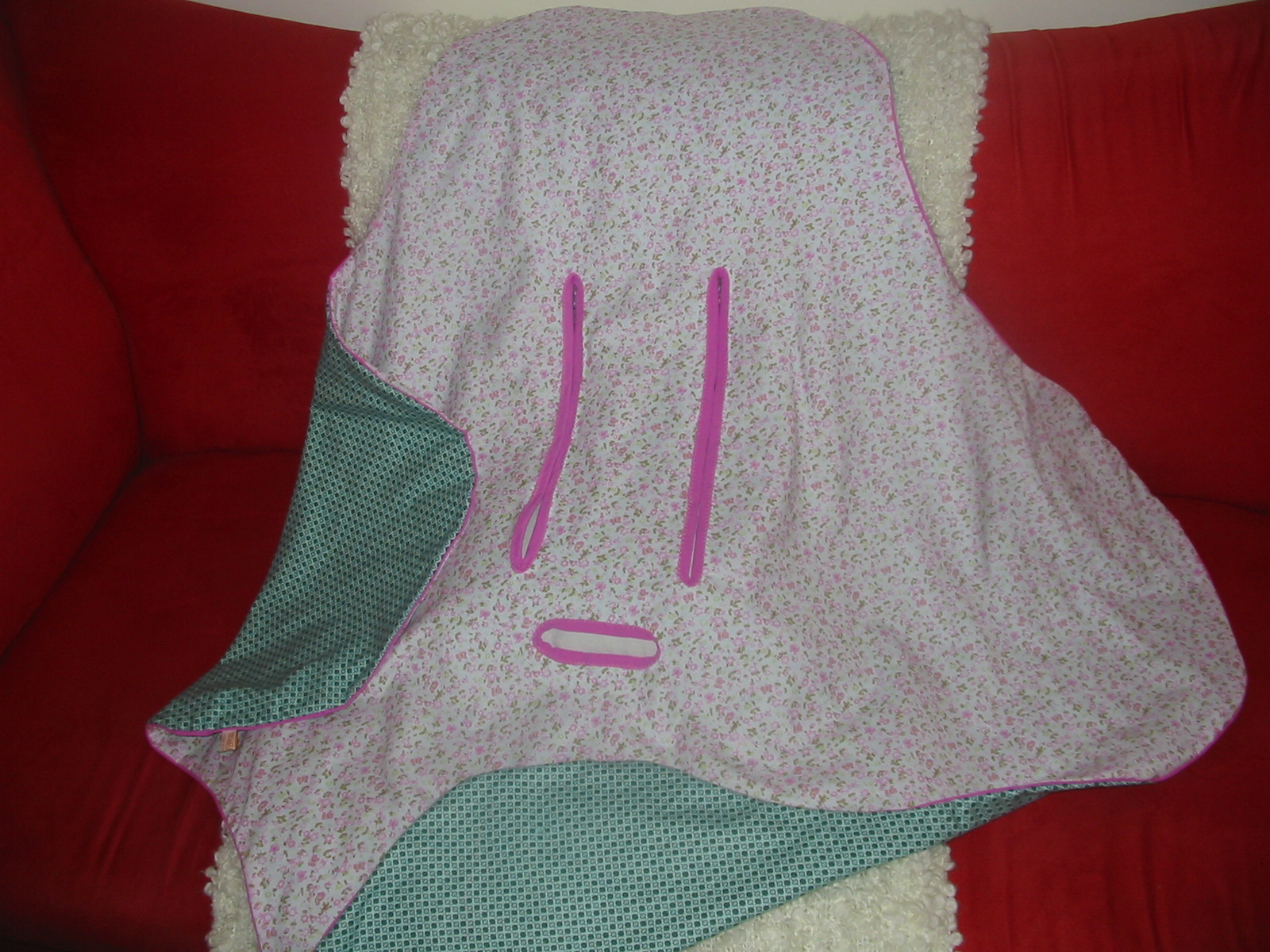 The Blanket Is Made In Shape Of A Rounded Plus Sign It Has Three Slits For Car Seat Straps Once Baby Bottom And Sides