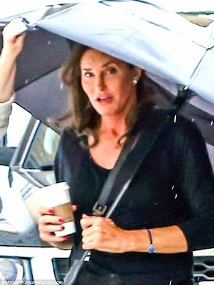 Photos: Caitlyn Jenner steps out in skinny jeans & knee high boots  298747B500000578-3119181-Happy_She_appeared_comfortable_in_her_skin_as_she_clutched_a_cof-a-17_1434016855720