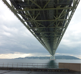 Akashi Kaikyo Bridge as seen from below in Maiko, Kobe. The bridge streches far into the distance where Awaji island is visible