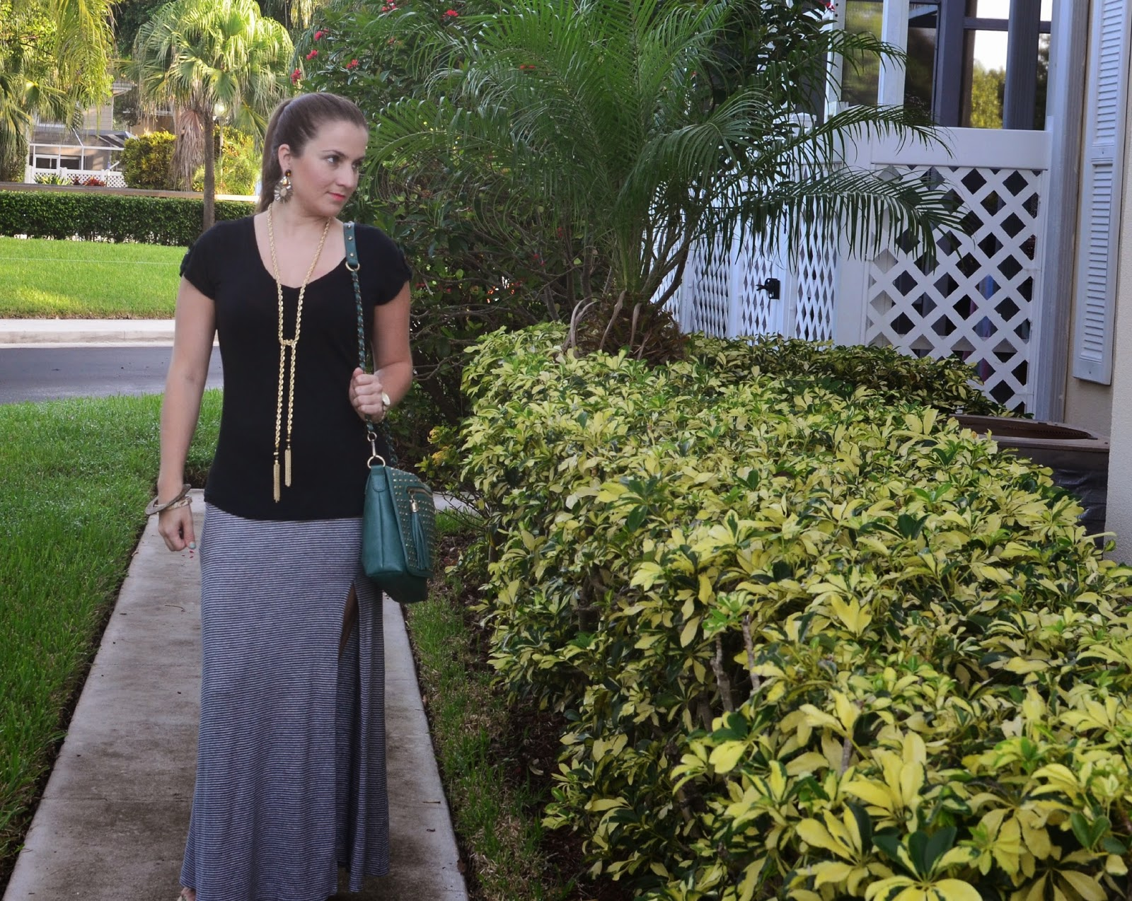 Striped maxi skirt - black tee - studded cross body - tassel necklace - Emma & Sophia