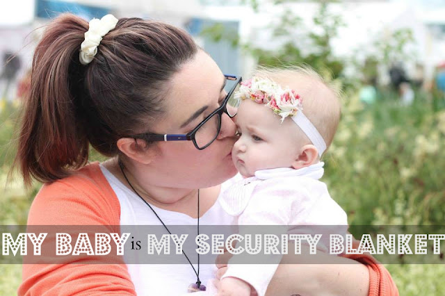 photo of mother kissing baby with text over saying my baby is my security blanket