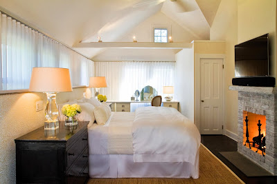 an almost all-white master bedroom furnished in ambiance