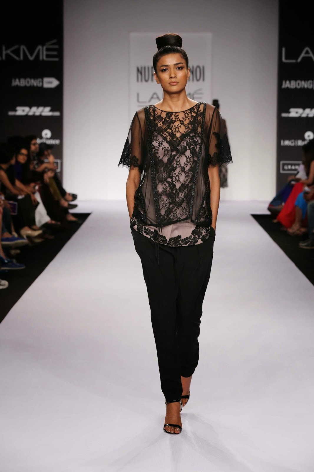 "Moving into the past when seduction in vintage cinemas of Europe, Hollywood and Bollywood played a major role, Nupur Kanoi's collection called ""Noir Jahaan"" for her Lakmé Fashion Week Summer/Resort 2014 was inspired by the feminine femme fatales of yesteryears."