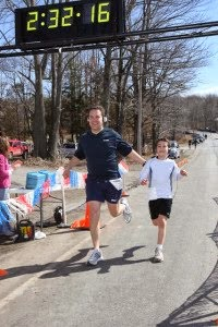 Justin at 6 finishing a half marathon