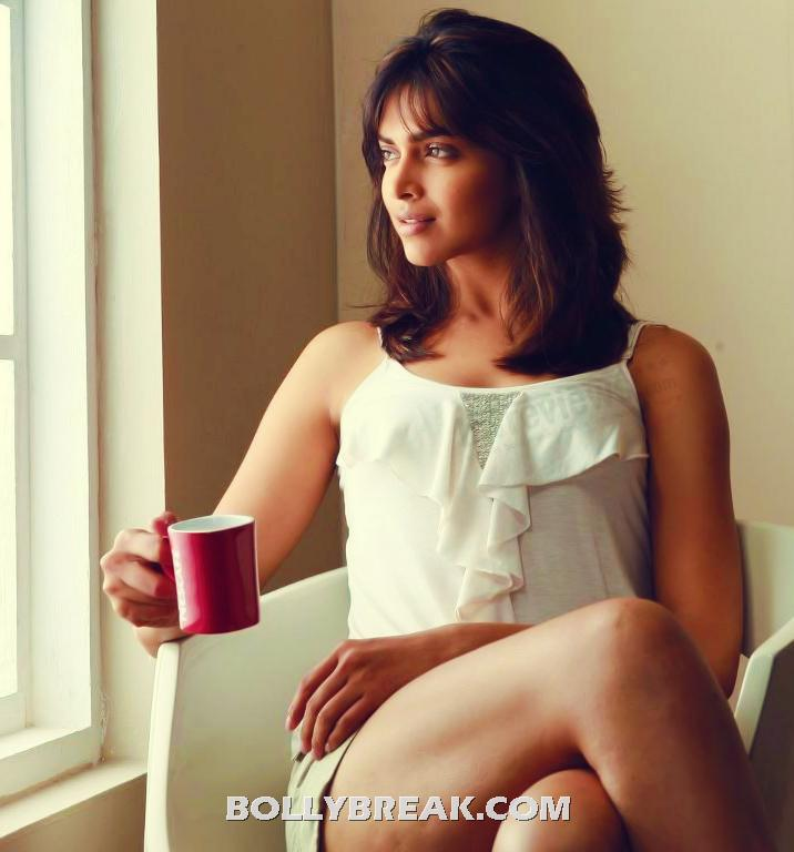 Deepika Padukone sipping coffee ross legged in shorts - Deepika Padukone sipping Coffee in shorts