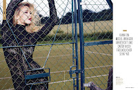 Bar Refaeli wearing a hot bodysuit and holding on to the fence