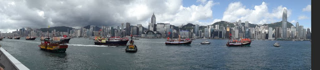 Panoramic view of Hong Kong Skyscrapers from Tsim Sha Tsui and Star Ferry Pier in Hong Kong