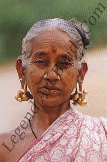 A VELLALAR WOMAN Tamil Nadu, Madurai; contemporary the abstract thandatti ear jewels are a favourite with women of this community.