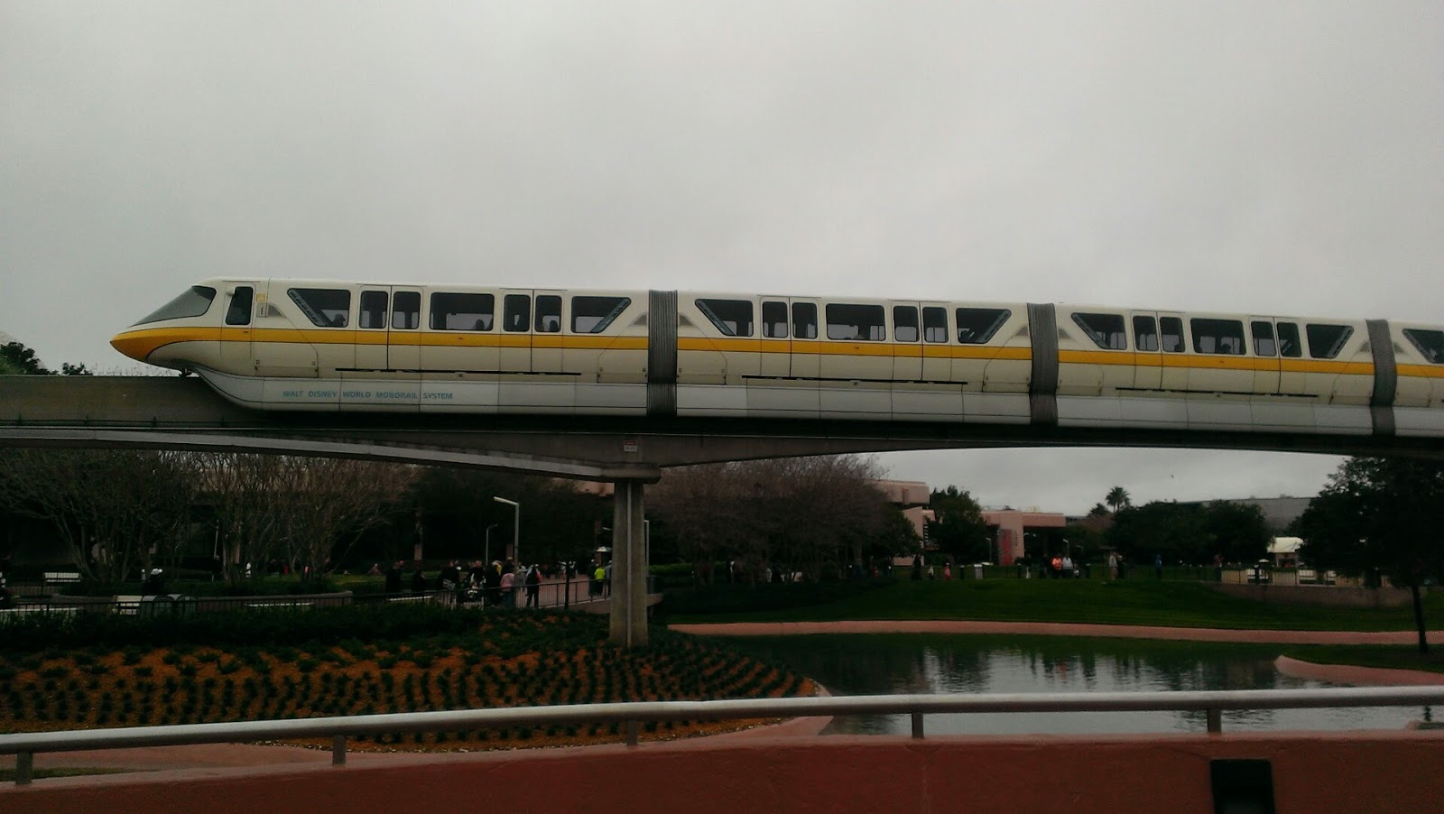 yellow monorail passing through disney's epcot
