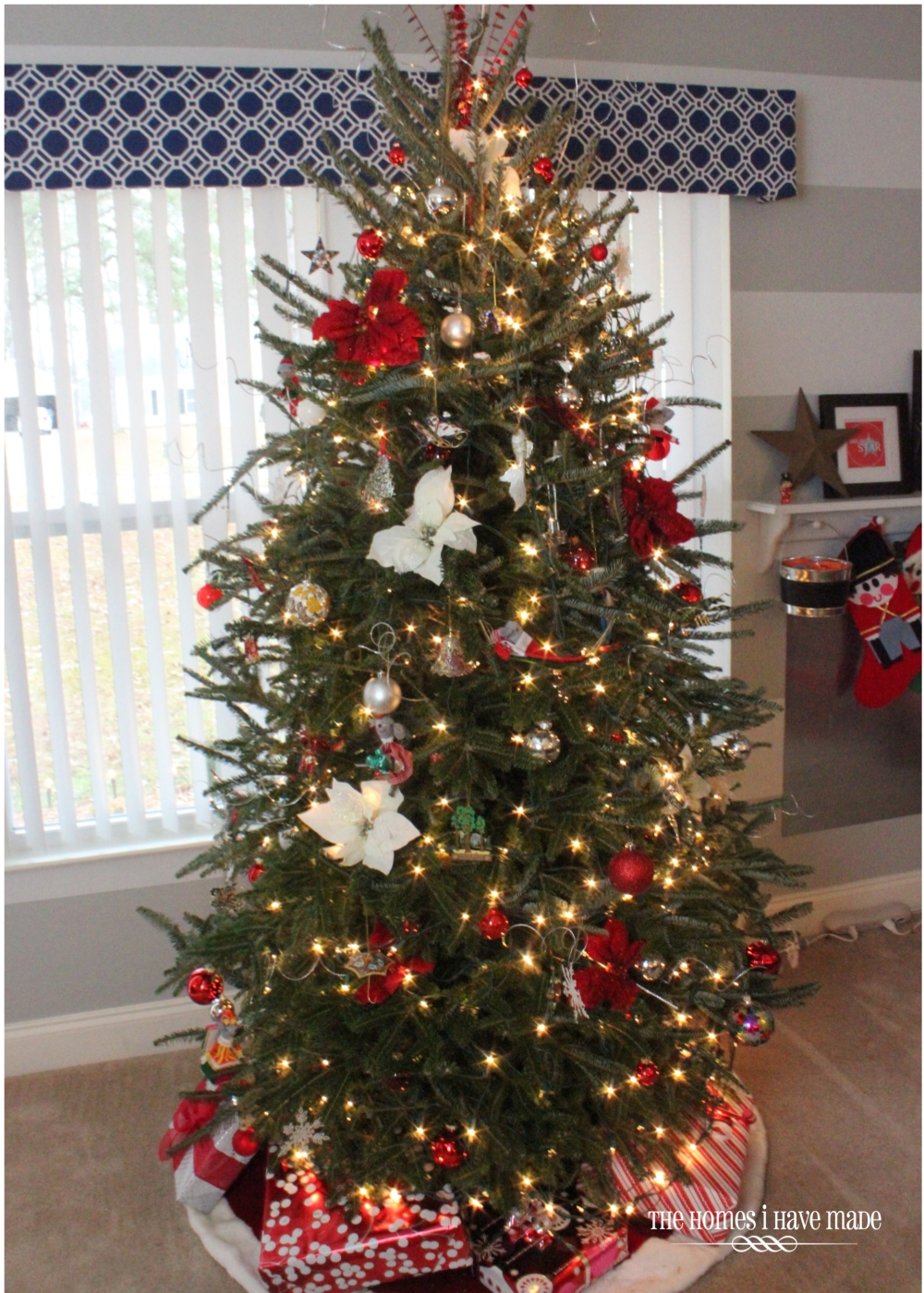 Red and silver decorated christmas tree - Our Tree Was Decorated In Shades Of Red White And Silver To Go With The Holiday Decor In The Entryway Behind It We Started By Putting Every Red