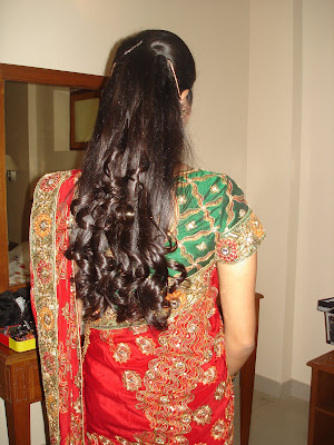 Rolled curly hair style made by North Indian bride.