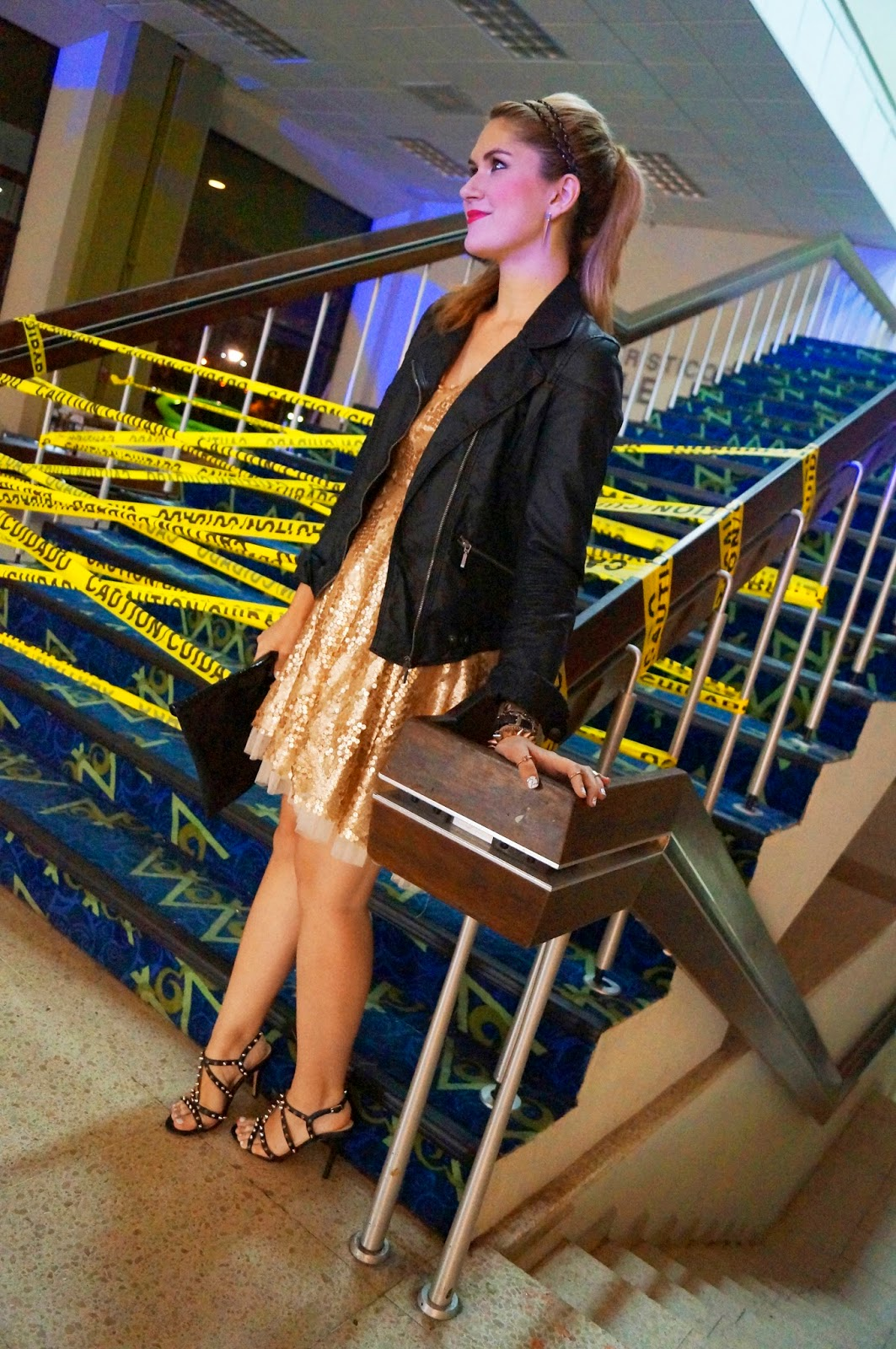 Add a motorcycle jacket to a gold sequin dress to look edgy!
