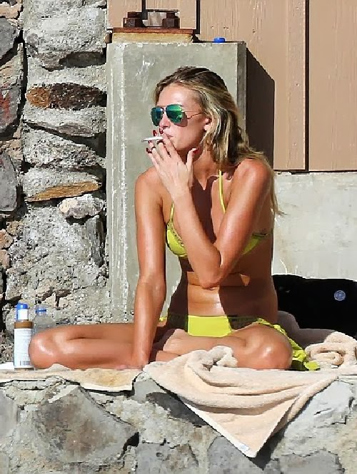 Paulina Gretzky strips down into a Yellow Bikini as she soaks up the sun in Hawaii