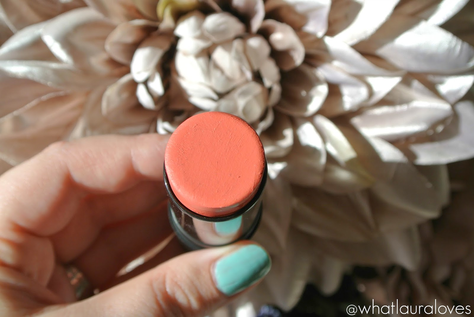 Makeup Revolution The One Blush Stick in Matte Rush worn on lips and cheeks