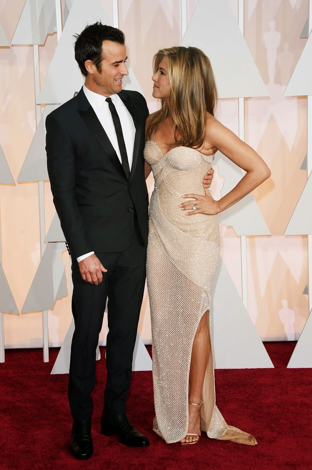 Jennifer Aniston sizzles in a sequinned Versace dress at the 2015 Oscars in Hollywood