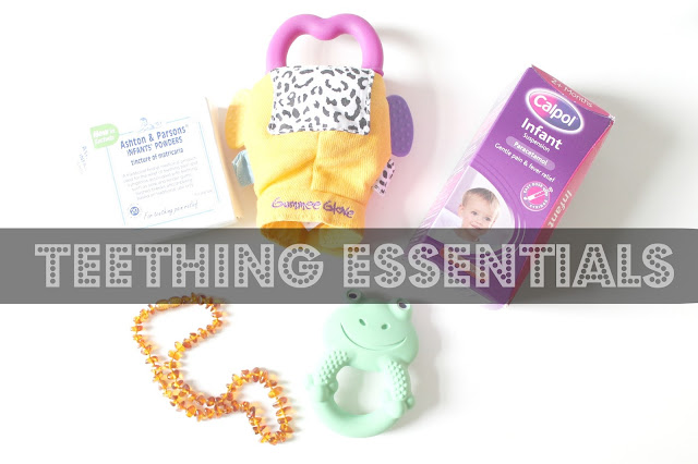 baby teething items scattered on table with text over 'teething essentials'