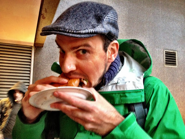 Devouring a duck brioche topped with blue cheese -  Real Food Market, South Bank, London