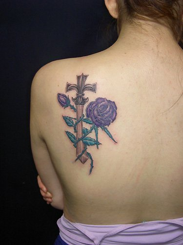 lejouroujesuismorte 6 lower back cross tattoos for